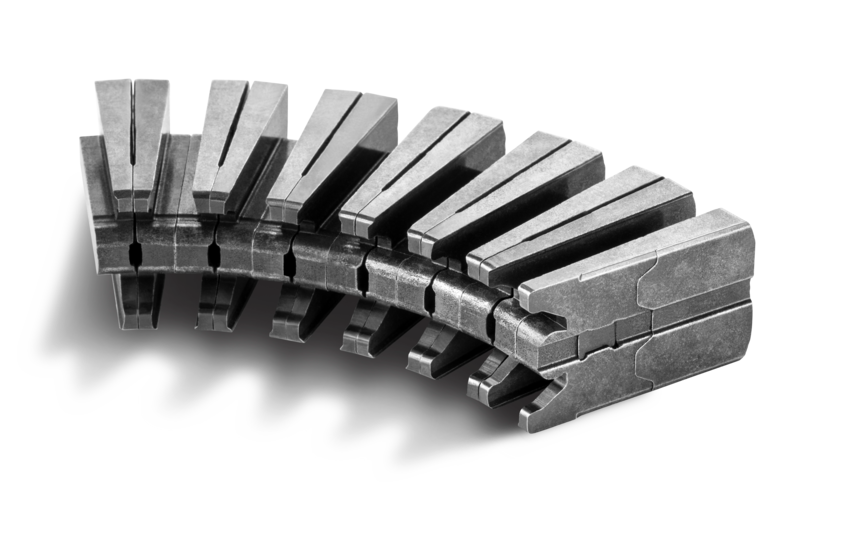 Coil carrier for use in electric motors or high-frequency electromagnetic applications