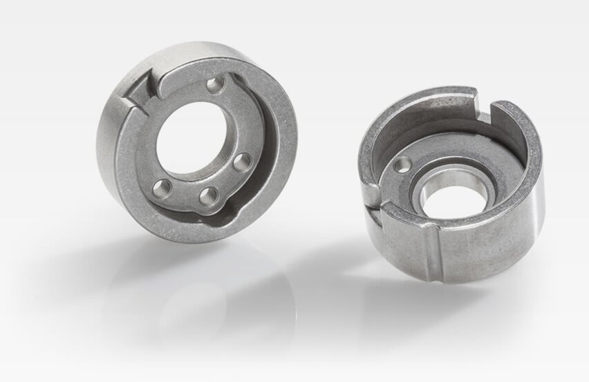 Spring adapter for camshafts to improve functional stability
